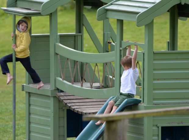 Wooden play area being enjoyed by youngsters